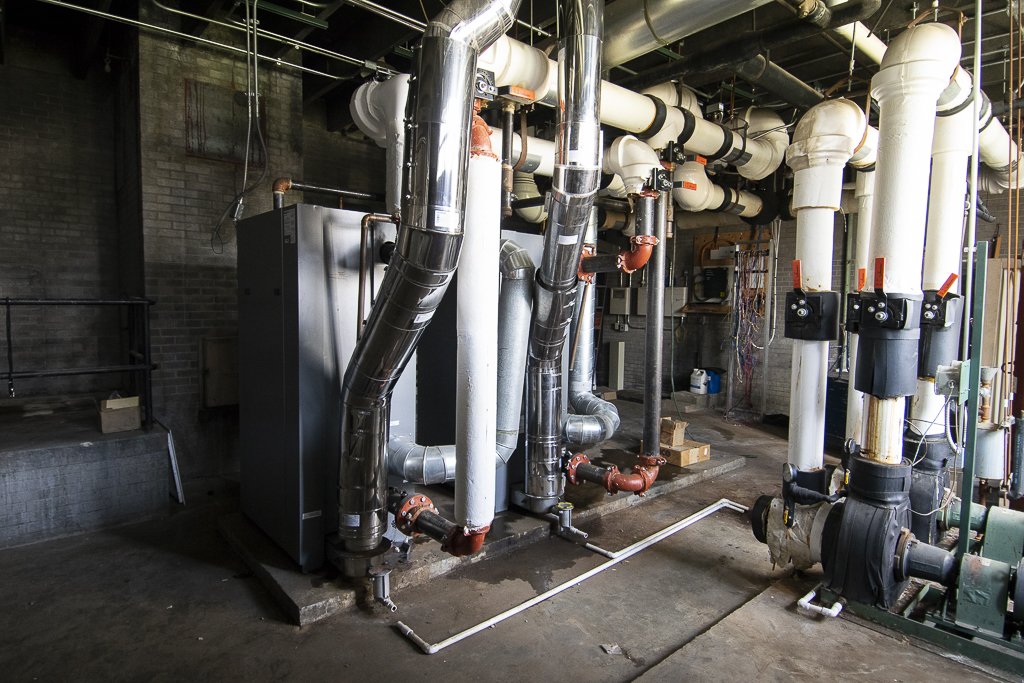 These two relatively new boilers (left side of photo) will be saved and possibly installed at Grissom Elementary. Photo by: Mike Rhodes