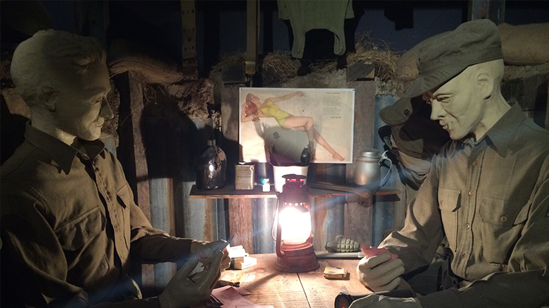 Ernie Pyle and a GI play cards in this recreated dugout scene. Photo by: Nancy Carlson