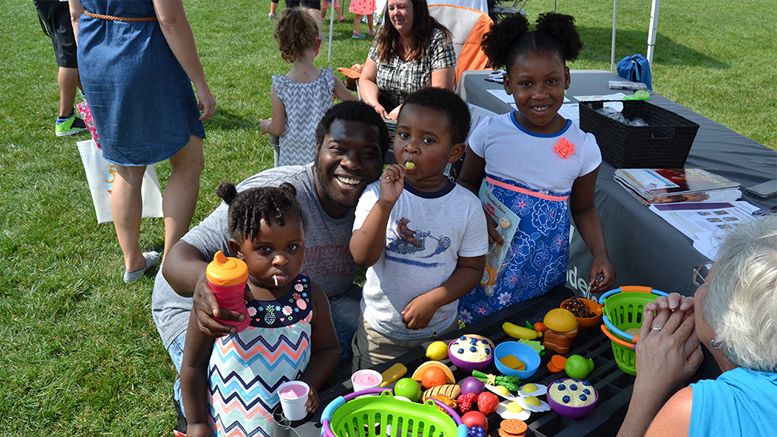 Families enjoy visiting community neighbors at Be My Neighbor Day 2017. Photo provided.