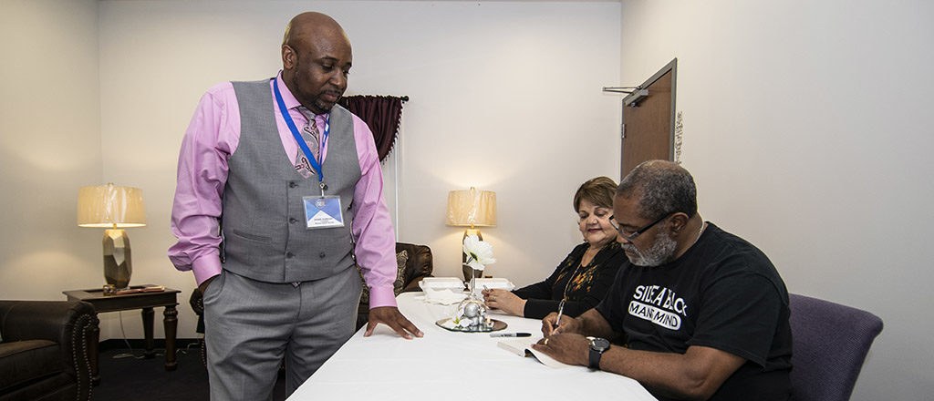 "Ron Stallworth and his wife Patsy are pictured as Ron signs a copy of his book ""BlacKkKlansman"" for Joseph Anderson, president of the Muncie NAACP branch. The book signing was held at Ron's book was turned into a Spike Lee film of the same name. The inscription Ron wrote was, ""To my brother from another mother."""