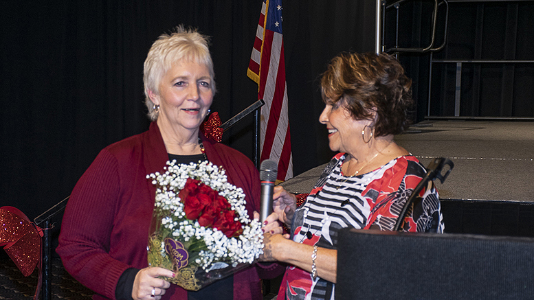 Pat Hart (L) executive director of the Delaware County Prevention Council is pictured receiving flowers from Carol Ammon (R), board vice president upon the announcement of Hart's retirement. Photo by: Mike Rhodes