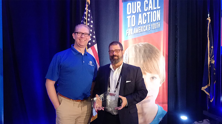 James Mitchell, Board President, and Jason Newman, Boys & Girls Clubs of Muncie CEO, accepted two awards at this year's Boys & Girls Clubs of America Regional Leadership Conference on October 11. Photo provided.