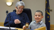 The Honorable Marianne L. Vorhees is pictured with a young child adopted on National Adoption Day. Photo by: Elizabeth Saylor