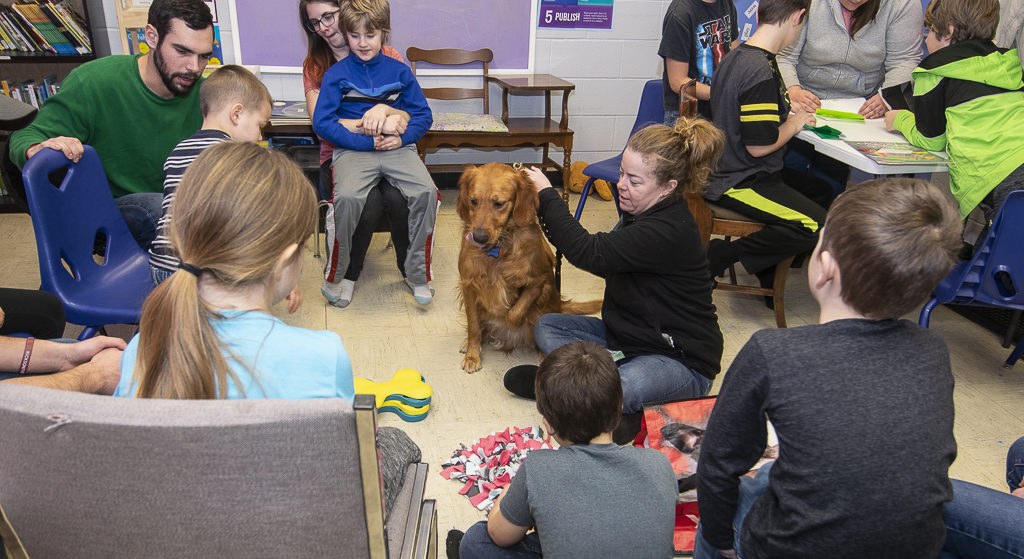Jackson the therapy dog and handler Megan Floyd visit the after school program at Ross Community Center. Photo by: Mike Rhodes