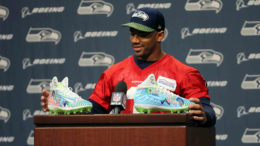 "During one of his regular weekly press conferences in November, Wilson unveiled his cleats, telling reporters Sydney ""did an amazing job with them."" (Photo courtesy of Seattle Seahawks)"