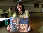 Tori Norris Murphy holds the girls' version of the Scouts BSA Handbook. Photo by: John Carlson