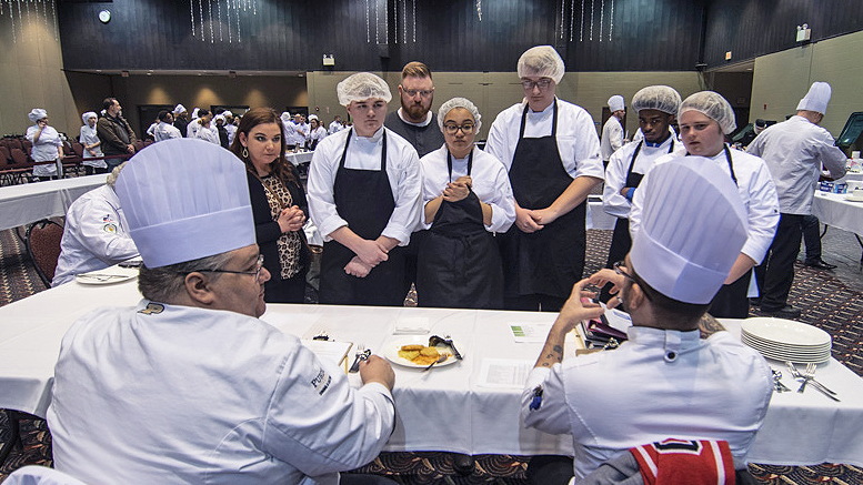 Chef judges provide feedback to students about their entry during the culinary STAR event. Photo by: Mike Rhodes