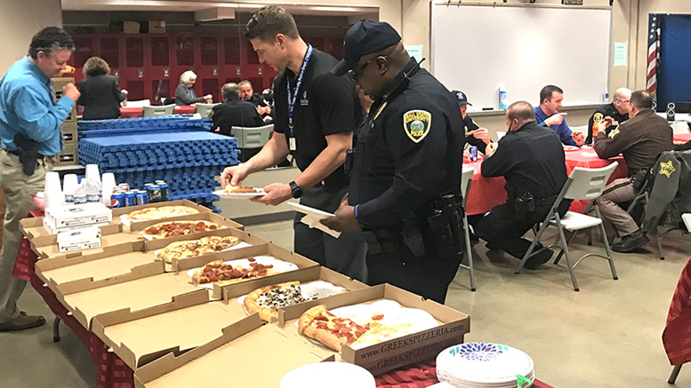 Officers enjoy a free lunch provided by the Ball State Federal Credit Union held at the university police department. Photo provided