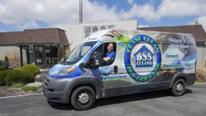 Mark Beaty is pictured in his carpet cleaning van in front of the offices of Woof Boom Radio. Photo by: Mike Rhodes