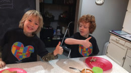 Aaron Hunter (right) interacts with his younger brother, Zachary. Photo provided