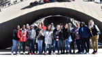 "Upward Bound students and chaperones gather at ""Cloud Gate"" in Millennium Park during their Spring Break trip to Chicago. Photo provided"