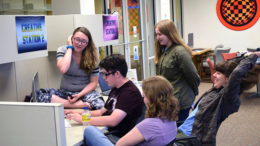 Students editing their video as a team during Summer Film School. Photo by: Stuart Cotton, Muncie Public Library