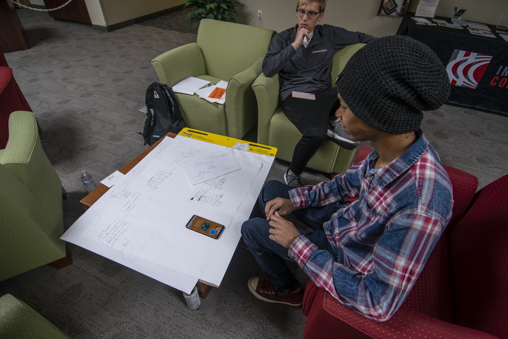 Aaron Best and Rashad J. Carter look over their plans for the Muncie Service Learning project. Photo by: Mike Rhodes