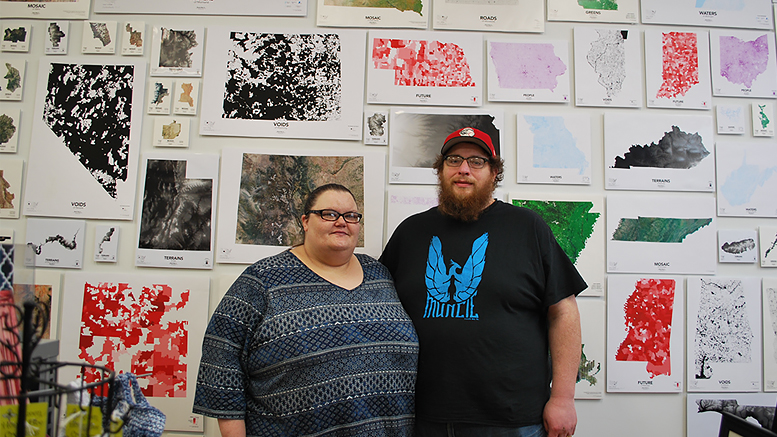Amy and Andy Shears are pictured in front of some of the custom maps available at the Muncie Map Company. Photo provided