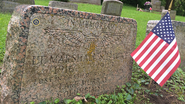 This flag in Beech Grove Cemetery decorates the grave of Lt. Marshall S. Hawke, a young Army flier killed in the crash of his B-25 back in 1943. Photo by: Nancy Carlson