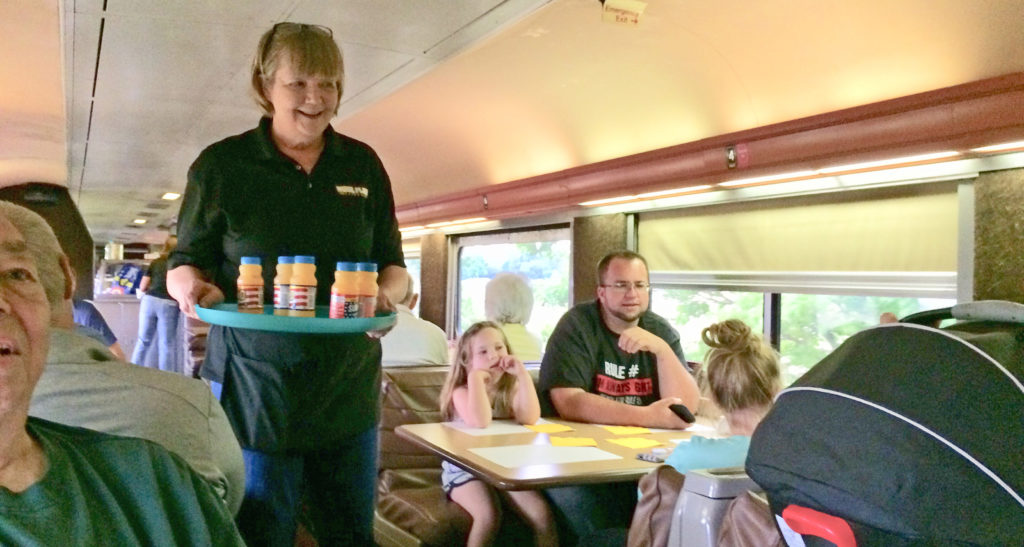 Attendants on the Nickel Plate Express work in the dining car. Photo by: Nancy Carlson