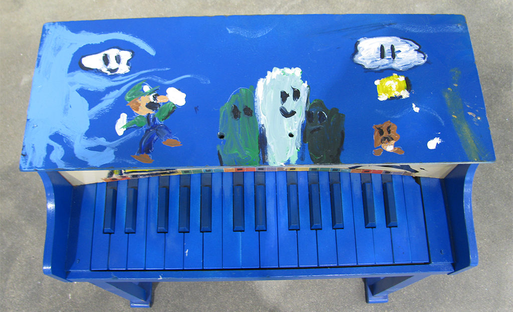 Super Mario Brothers favorite Luigi graces the top of this scene from artist Forrest King's video-game themed piano. Photo provided