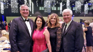 Pictured from L-R: Indiana Governor Eric Holcomb, Indiana First Lady Janet Holcomb, Nancy Larson-Lindell, and Steve Lindell, Master of Ceremonies for the event. Photo by: Ben Polk