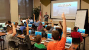 Ryan Hunter, co-founder of TechWise Academy, leads a Minecraft Party in which students get to learn about command blocks and play online in a safe environment. Photo provided