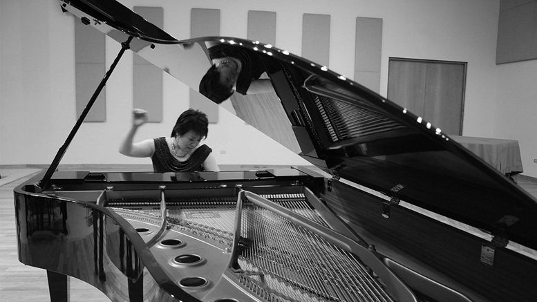 Dr. Angelin Chang at the grand piano. Photo provided