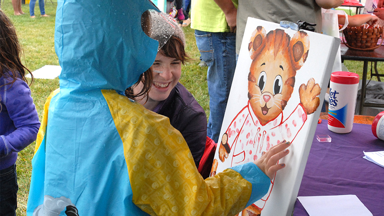 This Daniel Tiger painting was created at the Cornerstone Center for the Arts booth during the first Be My Neighbor Day in 2015. Kids painted Daniel's sweater with their thumbprints. Photo provided