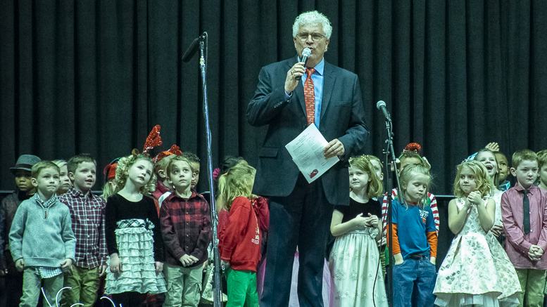 Steve Lindell is pictured at the annual Christmas Sing with children from West View Elementary. Photo by: Mike Rhodes