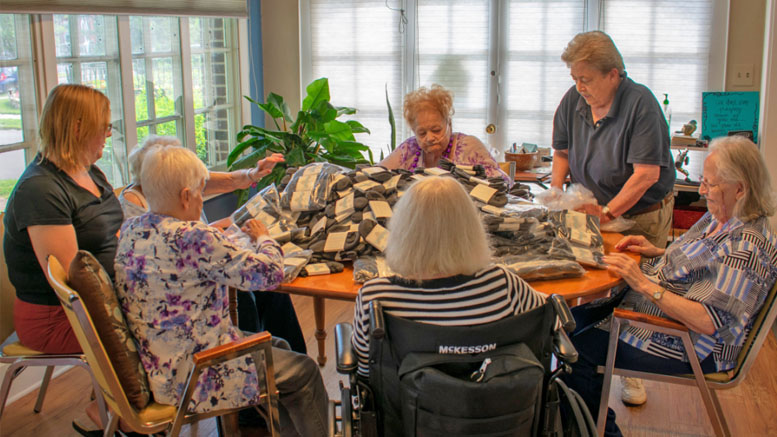 Alpha Center, Inc. provides adult day services for the elderly. The Community Foundation awarded Alpha Center a $15,000 grant to support operations and programming, like this quilting activity for clients. Photo provided