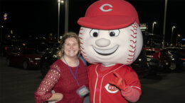 "Megan Orbin from Woof Boom Radio is pictured with ""Mr. RedLegs."" Photo by Mike Rhodes"