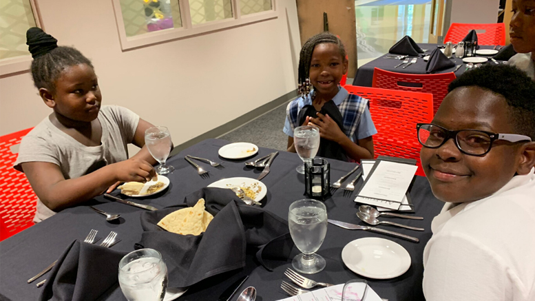 Motivate Our Minds was awarded $20,000 for its 2020-2021 After-School Enrichment Program. A similar grant in 2019 supported Motivate Our Minds. Pictured, students take part in an etiquette dinner as part of the enrichment opportunities provided by Motivate Our Minds.