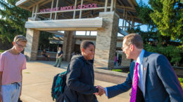 Ball State University President Geoffrey S. Mearns greets students as they attend class at Southside Middle School. Photo provided
