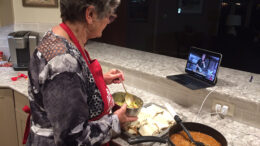One eye on her iPad and one on her bowl, Nancy makes some fresh guacamole. Photo by John Carlson