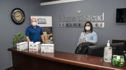 "Steve Leach, Franchise Manager and Kiara Dunson, Administrative Assistant at Home Instead are pictured with a few boxes of masks supplied by Mayor Ridenour's ""Masks for Muncie"" project.The company received 1,250 masks. Photo by Mike Rhodes"